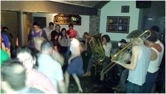 An image from the Cork Jazz Dance Exchange. On the right is the Oldfish Jazzband, and on the left are various dancers having a wonderful time at the PorterHouse. I'm the completely washed out woman in the foreground.